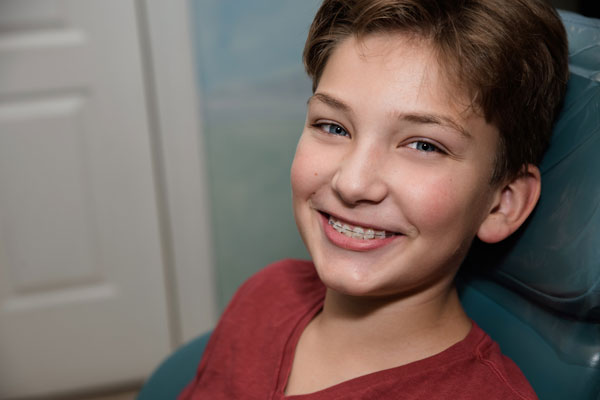 a smiling patient with braces from Naborowski Orthodontics