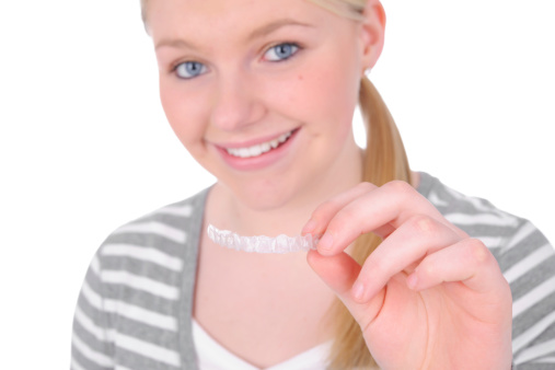 a smiling teen with Invisalign from Naborowski Orthodontics